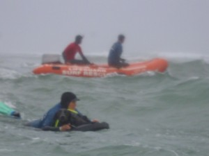 Practicing swiftwater rescue of a dog